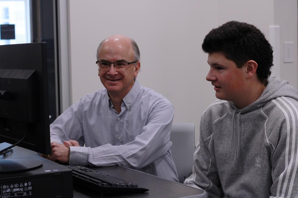 David Haining working with a student