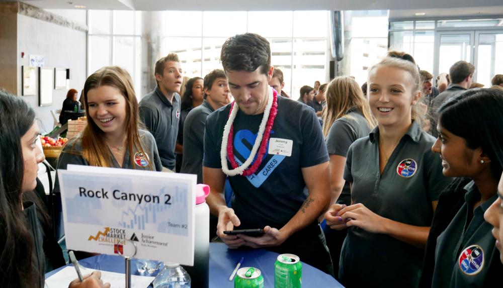 JA volunteer at JA Stock Market Challenge with Rock Cayon students